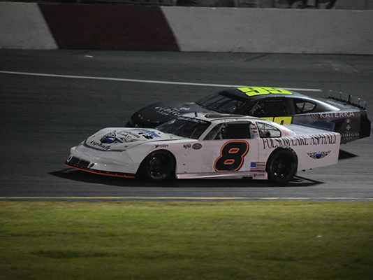 Jason Romero (8) on his way to victory Saturday night at All American Speedway.
