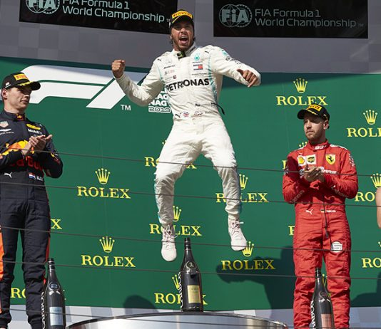 Lewis Hamilton celebrates his victory in the Hungarian Grand Prix. (Steve Etherington Photo)