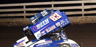 Daryn Pittman (83) races under Cory Eliason at Southern Iowa Speedway. (Paul Arch photo)