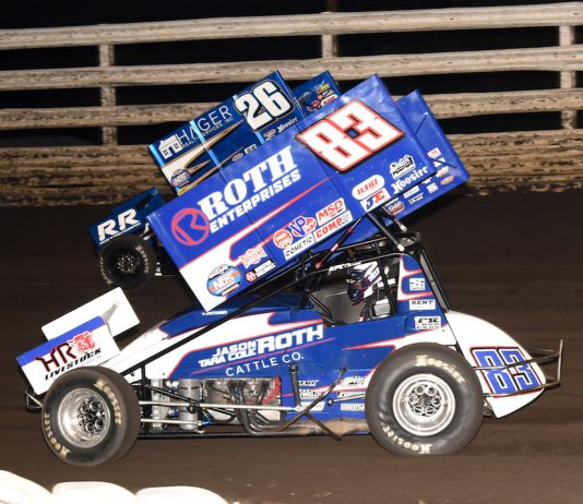 Daryn Pittman (83) races under Cory Eliason at Southern Iowa Speedway. (Paul Arch photo)