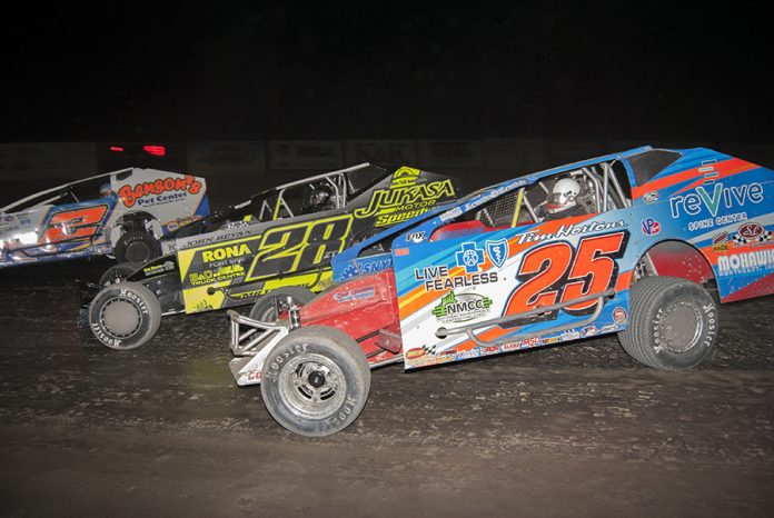 Erick Rudolph (25) en route to victory at Merrittville Speedway. (DIRTcar photo)