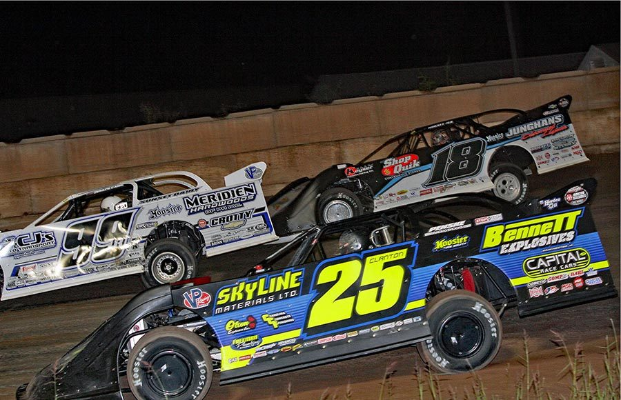 Shane Clanton (25) races under Chase Junghans (18) and Boom Briggs during Tuesday's World of Outlaws Morton Buildings Late Model Series event at Shawano Speedway. (Jim Denhamer Photo)