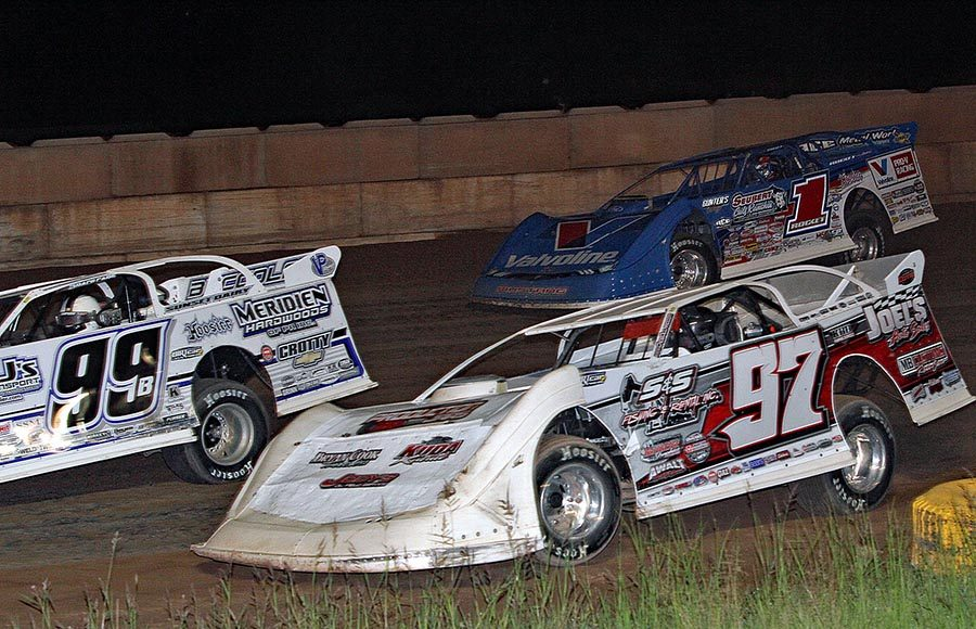 Cade Dillard (97) races alongside Boom Briggs (99B) and Brandon Sheppard during Tuesday's World of Outlaws Morton Buildings Late Model Series event at Shawano Speedway. (Jim Denhamer Photo)