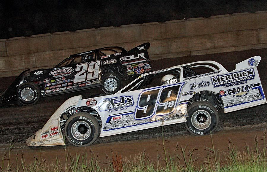 Boom Briggs (99b) battles alongside Darrell Lanigan during Tuesday's World of Outlaws Morton Buildings Late Model Series event at Shawano Speedway. (Jim Denhamer Photo)
