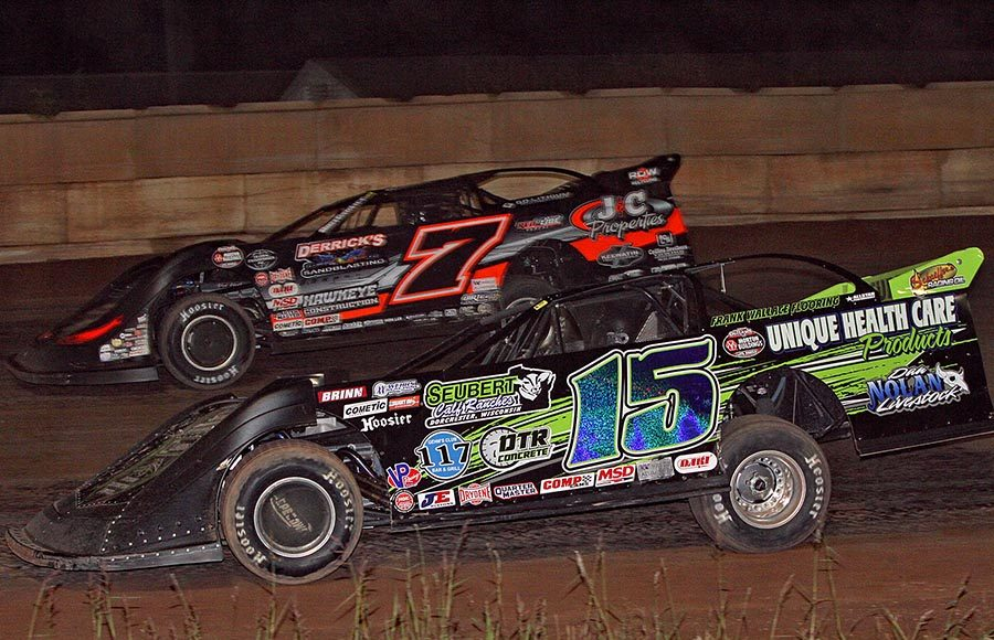 Nick Anvelink (15) races under Ricky Weiss during Tuesday's World of Outlaws Morton Buildings Late Model Series event at Shawano Speedway. (Jim Denhamer Photo)