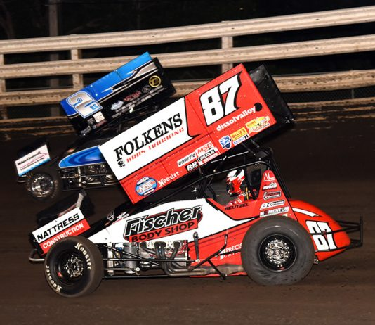 Aaron Reutzel (87) chases Austin McCarl during Monday's Front Row Challenge at Southern Iowa Speedway. (Paul Arch Photo)