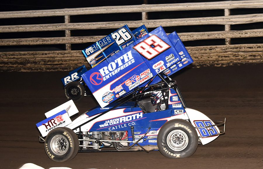 Daryn Pittman (83) races to the inside of Cory Eliason during Monday's Front Row Challenge at Southern Iowa Speedway. (Paul Arch Photo)