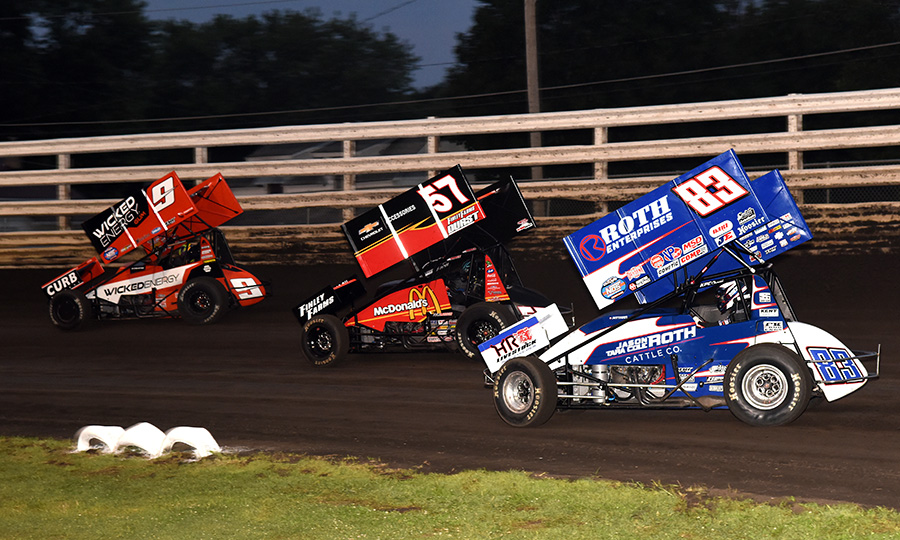 James McFadden (9) leads Kyle Larson (57) and Daryn Pittman during Monday's Front Row Challenge at Southern Iowa Speedway. (Paul Arch Photo)