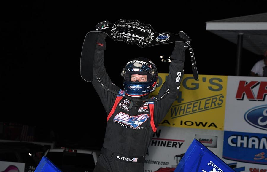 Daryn Pittman races the Front Row Challenge championship belt in victory lane Monday at Southern Iowa Speedway. (Frank Smith Photo)