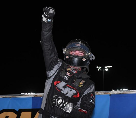 Trey Starks celebrates victory at Knoxville Raceway. (Frank Smith photo)