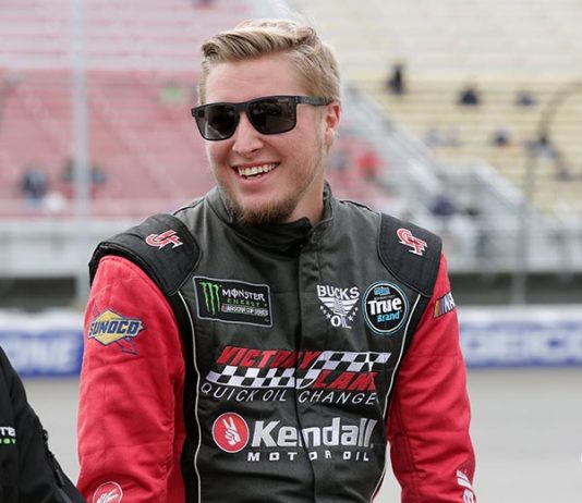 Garrett Smithley will return to Spire Motorsports Sunday at Michigan Int'l Speedway.