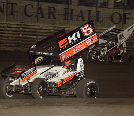 Shane Stewart (5) leads Dominic Scelzi Friday during the Hard Knox feature at Knoxville Raceway. (Mark Funderburk Photo)