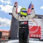 Marc Miller celebrates after winning Saturday's Trans-Am Series TA2 event at the Mid-Ohio Sports Car Course.