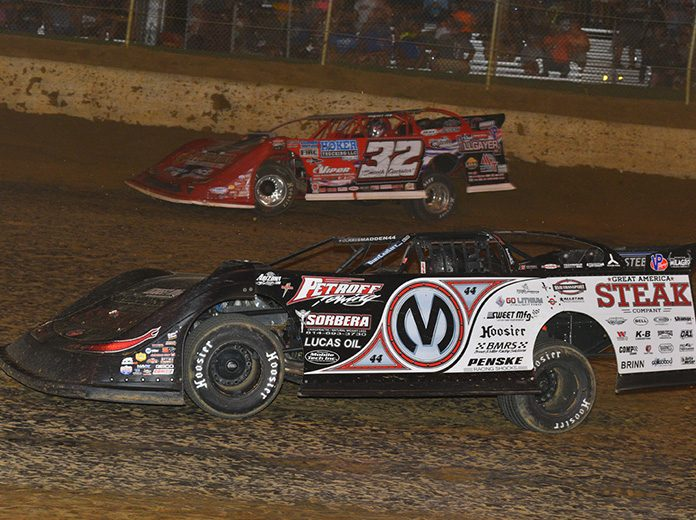 Chris Madden (0m) races under Bobby Pierce during Saturday's North/South 100 at Florence Speedway. (Michael Moats Photo)