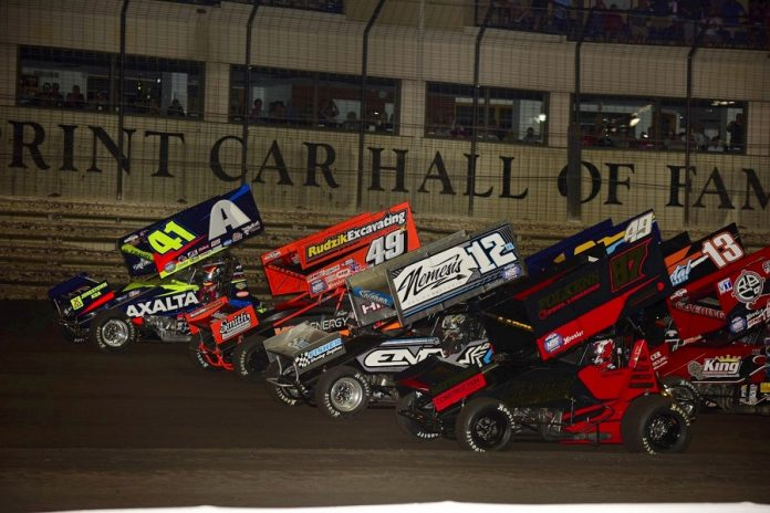 The four-wide parade lap prior to Saturday's 59th annual NOS Energy Drink Knoxville Nationals finale. (Mark Funderburk photo)
