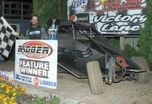 Thomas Meseraull in victory lane at Angell Park Speedway.