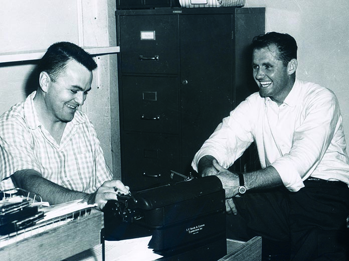 Chris Economaki (left) spent many years slaving over his typewriter at racing venues across the world.