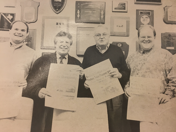 (From left) SPEED SPORT's Mike Kerchner, Mario Andretti, Chris Economaki and Ron Lemasters Jr. pose with copies of National Speed Sport News.