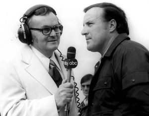 Chris Economaki (left) interviews A.J. Foyt. (NSSN Archives Photo)