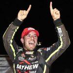 Doug Coby celebrates after winning Wednesday's NASCAR Whelen Modified Tour race at Thompson Speedway Motorsports Park. (NASCAR Photo)