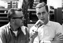 Chris Economaki (left) interviews Roger Penske. (NSSN Archives Photo)