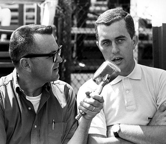 Chris Economaki (left) interviews Roger Penske. (NSSN Archives Photo)
