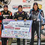 Chris Madden (center) is joined on the podium by Brandon Overton and Scott Bloomquist. (LOLMDS photo)