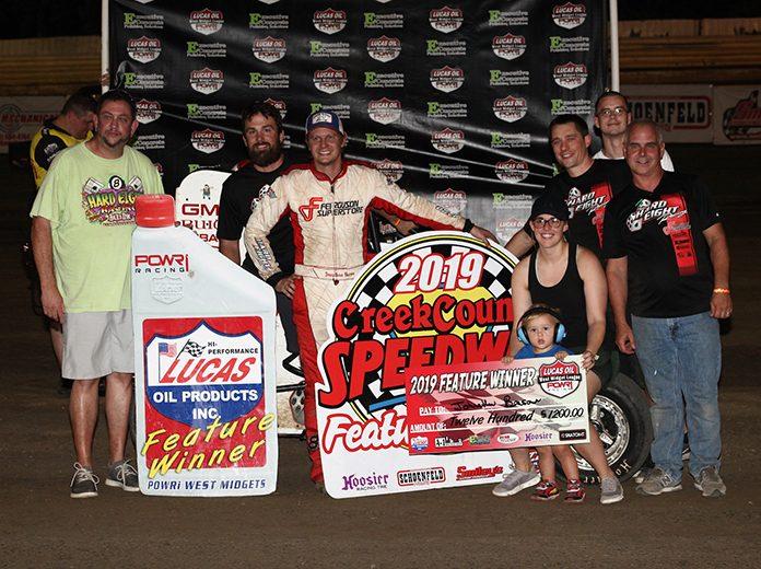Jonathan Beason in victory lane Friday at Creek County Speedway. (Richard Bales Photo)