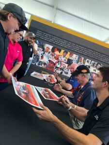 Fans wait in line for autographs from current and past IMSA legends at the olex Monterey Motorsports Reunion. (IMSA Photo)