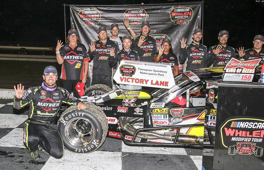 Doug Coby and his team pose in victory lane after winning the Bud King of Beers 150 at Thompson Speedway Motorsports Park. (Dick Ayers Photo)