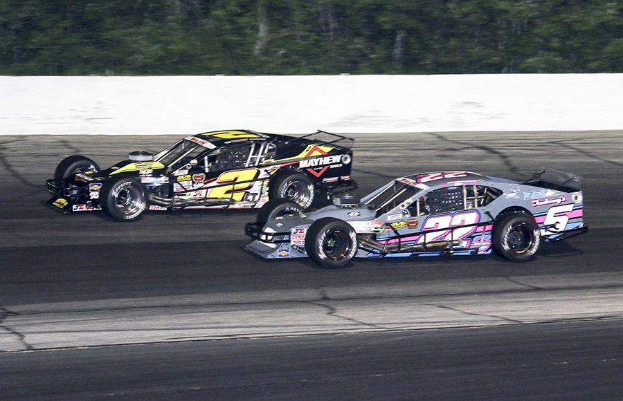 Doug Coby (2) races around the outside of Kyle Bonsignore during Wednesday's NASCAR Whelen Modified Tour feature at Thompson Speedway Motorsports Park. (Dick Ayers Photo)