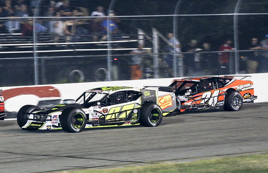 Patrick Emerling (07) races ahead of Andrew Krause during Wednesday's NASCAR Whelen Modified Tour feature at Thompson Speedway Motorsports Park. (Dick Ayers Photo)