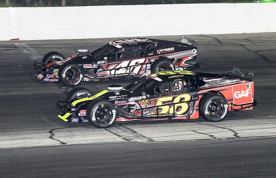 Craig Lutz (46) battles Eric Goodale during Wednesday's NASCAR Whelen Modified Tour feature at Thompson Speedway Motorsports Park. (Dick Ayers Photo)