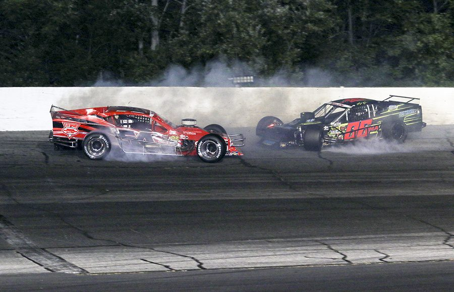Tommy Catalano (54) and Sam Rameau crash during Wednesday's NASCAR Whelen Modified Tour feature at Thompson Speedway Motorsports Park. (Dick Ayers Photo)