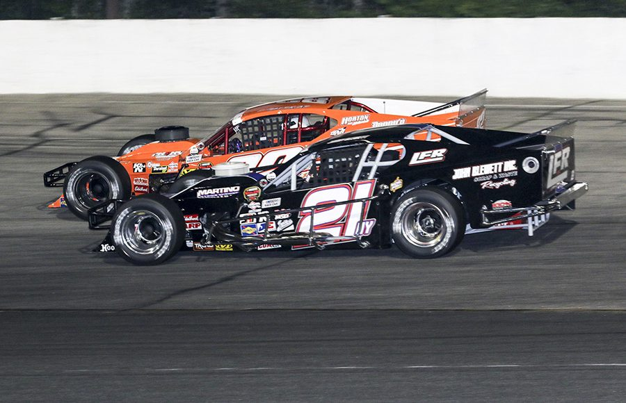 Jimmy Blewett (21) battles alongside Woody Pitkat during Wednesday's NASCAR Whelen Modified Tour feature at Thompson Speedway Motorsports Park. (Dick Ayers Photo)