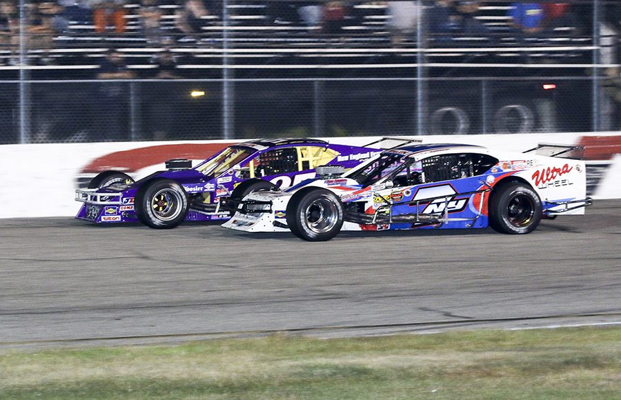 Jon McKennedy (7) races under Ron Silk during Wednesday's NASCAR Whelen Modified Tour feature at Thompson Speedway Motorsports Park. (Dick Ayers Photo)