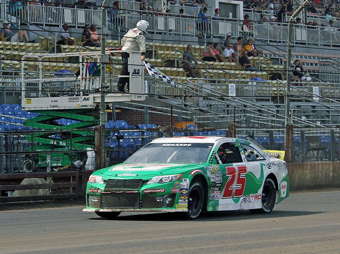 Michael Self takes the checkered flag to win the Allen Crowe 100 Sunday afternoon. (Jim Denhamer Photo)