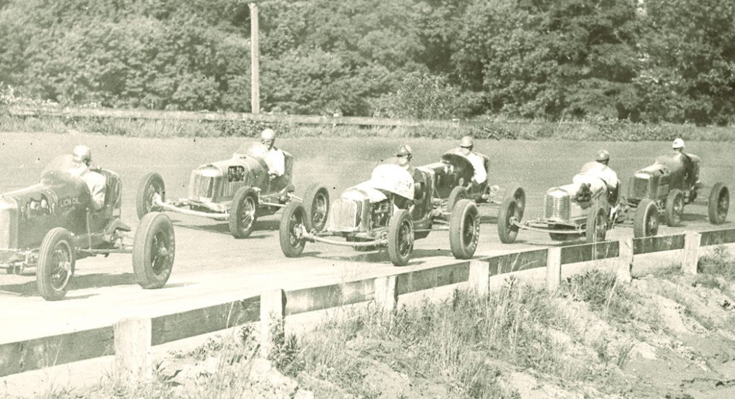 Big cars race to the start during the 1930s;