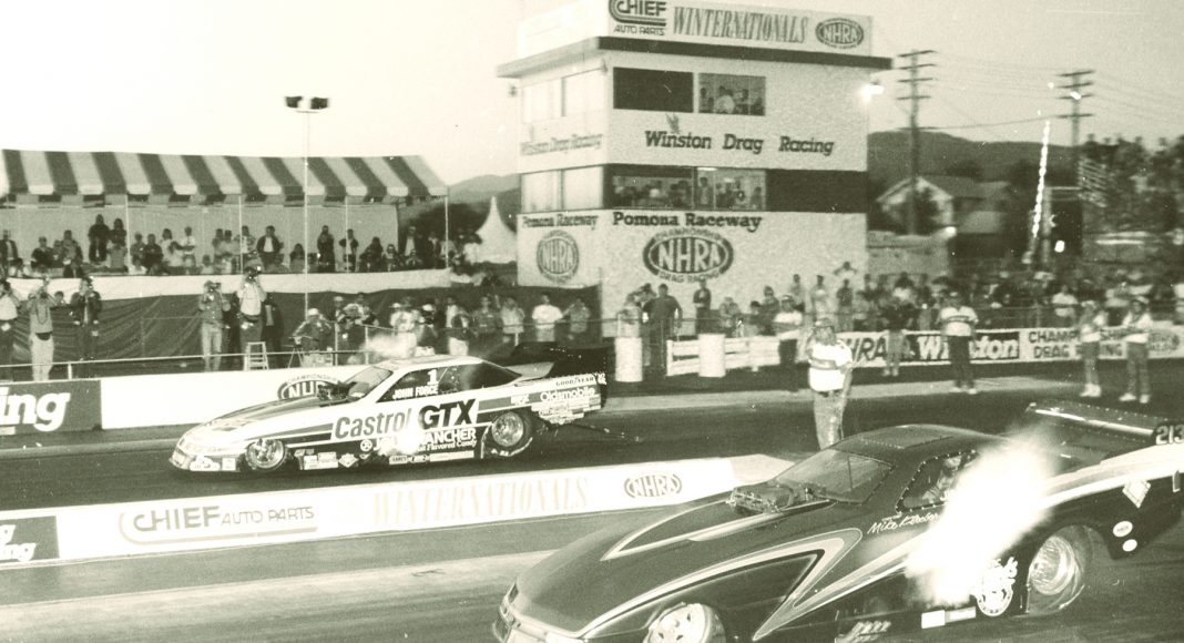 John Force (far lane) battles Jim Epler at Auto Club Raceway at Pomona in 1990.