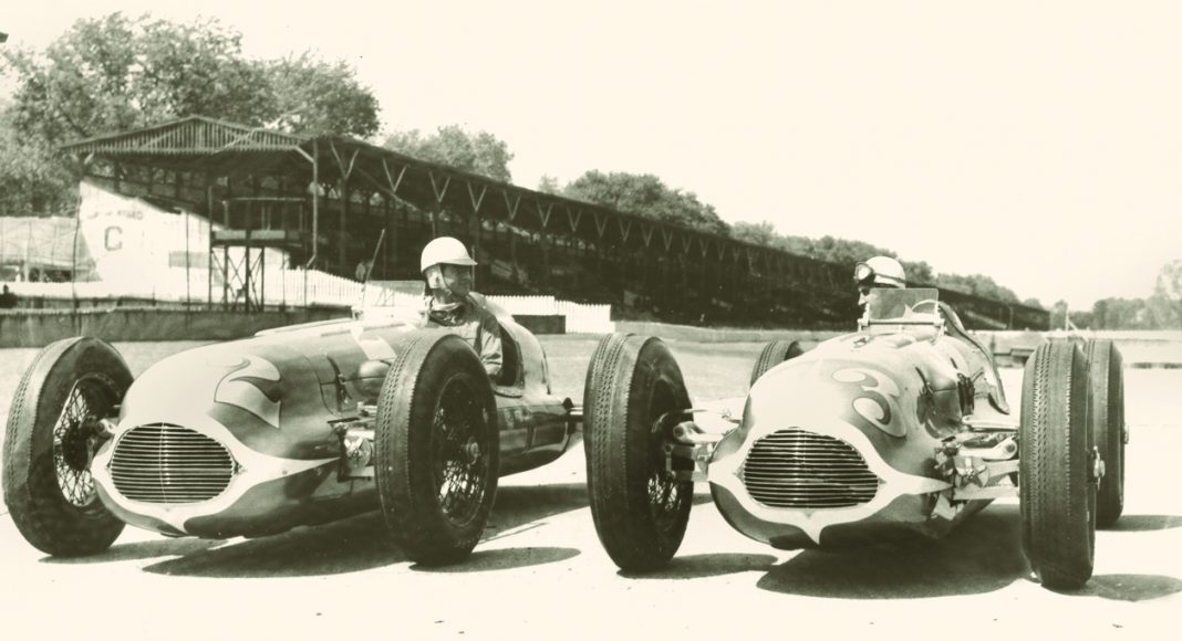 1948 Indianapolis 500 winner Mauri Rose (right) and runner-up Bill Holland pose for photographers at Indianapolis Motor Speedway.