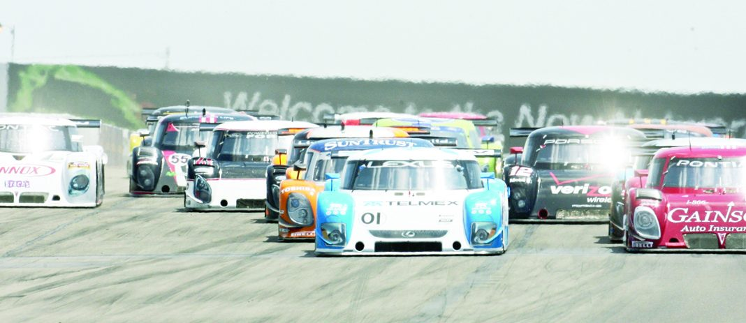 Grand-Am sports car racers charge into turn one at Watkins Glen (N.Y.) Int'l in 1999.
