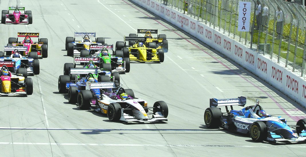 Champ Car World Series competitors fight for position during a late-1990s Grand Prix of Long Beach.