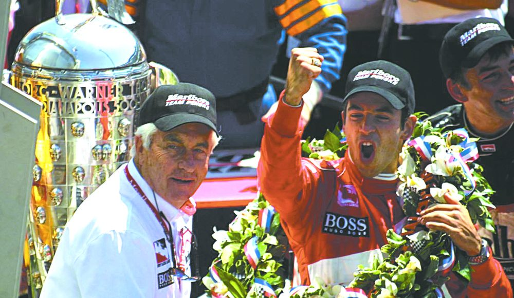 Roger Penske and Hello Castroneves in victory lane at Indianapolis Motor Speedway.