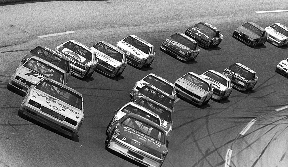 Dale Earnhardt and Bill Elliott lead the NASCAR Cup Series field at Talladega (Ala.) Superspeedway in 1987.