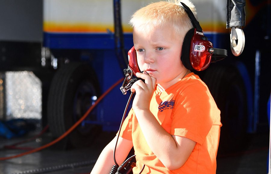 Kelby Eilen talking over the radio with his dad, ARCA Midwest Tour driver Jonathan Eilen, Friday at Madison Int'l Speedway. (Doug Hornickel Photo)
