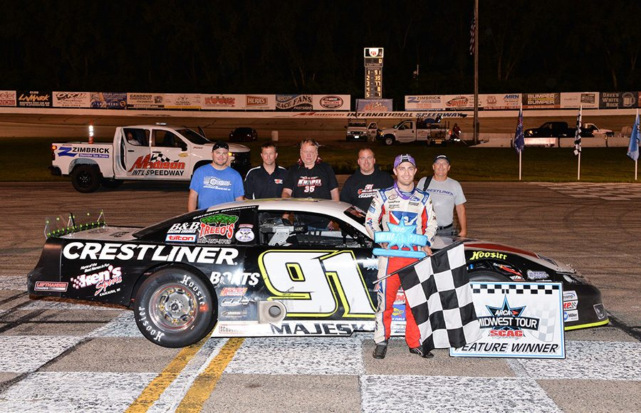 Ty Majeski poses in victory lane with his crew after winning Friday's Howie Lettow Classic at Madison Int'l Speedway. (Doug Hornickel Photo)