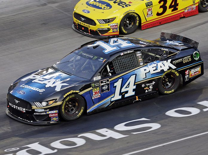 Clint Bowyer's crew chief Michael Bugarewicz was one of three crew chiefs to be fined $10,000 for loose lug nuts after Saturday's race at Bristol Motor Speedway. (HHP/Alan Marler Photo)
