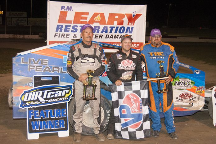 Erick Rudolph (center) shares victory lane with Lance Willix II and Tim Fuller. (DIRTcar photo)