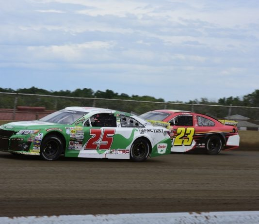 Michael Self (25) passes Bret Holmes during Sunday's ARCA Menards Series Allen Crowe 100 at the Illinois State Fairgrounds. (Mark Funderburk photo)