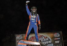 Justin Grant celebrates victory at Kokomo Speedway. (Jim DenHamer photo)